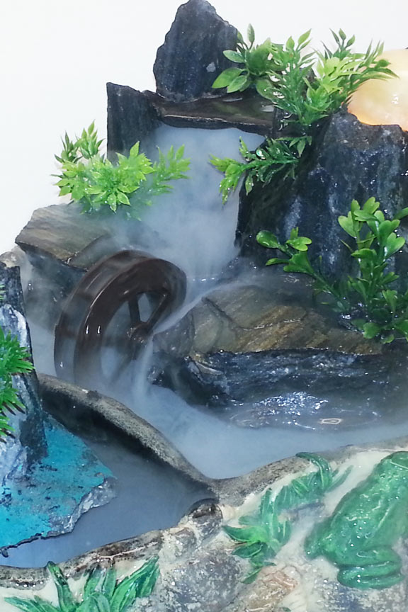 Tranquil pond feng shui fountain for Water feature feng shui
