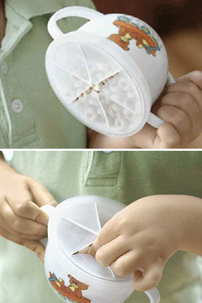 Tip the cup without spilling the contents.